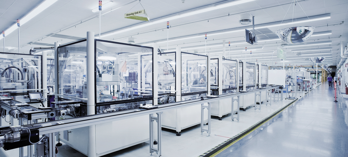 An Omron integrated robot solution with more than a dozen Omron robots working on a manufacturing assembly line.