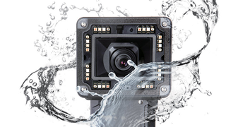 Camera surrounded by water.